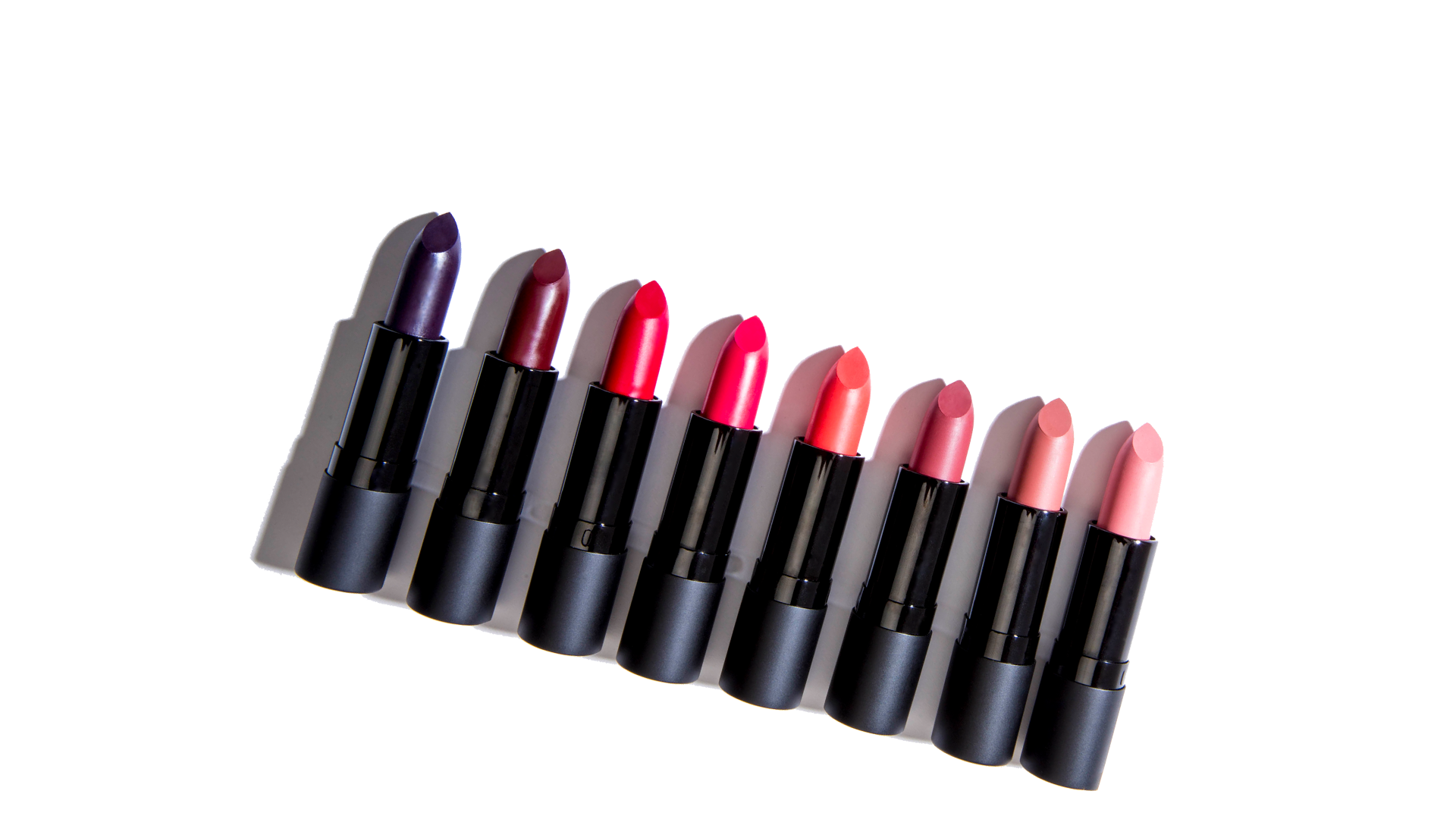 Row of a variety of uncapped Lux Lipstick sticks